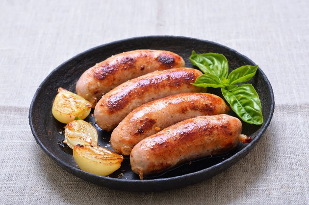 Grilled sausages in frying pan