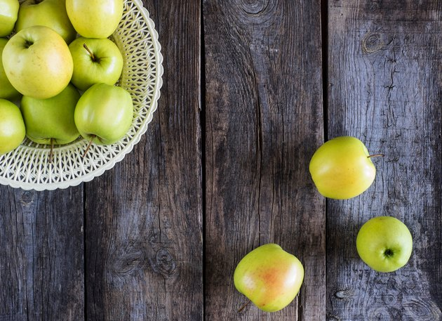 Directly Above Shot Of Granny Smith Apples On Wooden Table