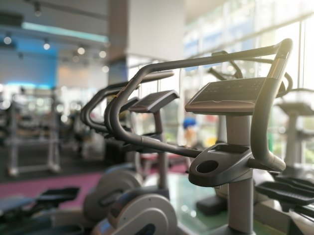 Part of Step Airwalk machines at fitness gym. - Selective focus