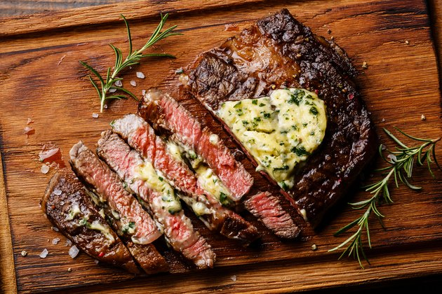 Sliced grilled steak Ribeye with herb butter
