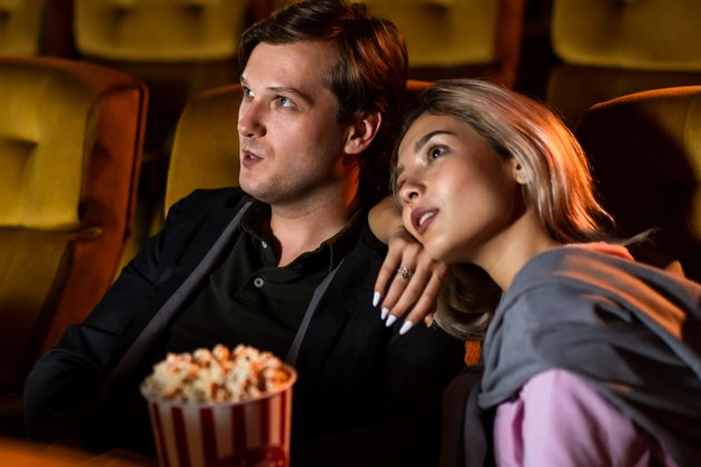 Caucasian lover watching a movie in the cinema