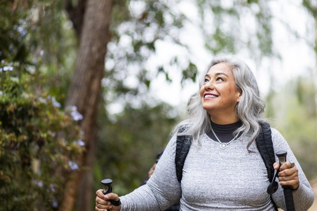 Senior Mexican woman with type 2 diabetes hiking for exercise