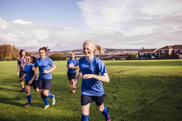 Healthy teenage girls with normal heart rates on sports field