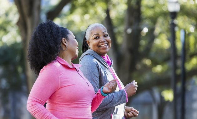 Mature African-American women in city, exercising