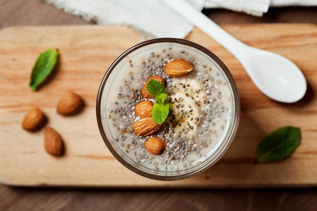 High protein breakfast chia seed pudding with oat, banana and almonds and mint