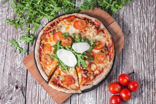 Vegetarian pizza with mozzarella and arugula.