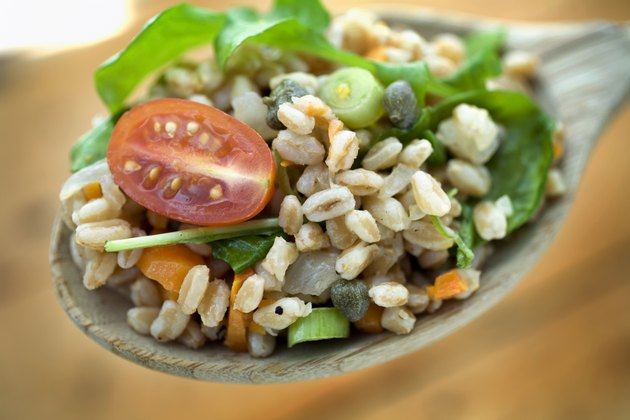 Farro salad on spoon for cheap protein foods