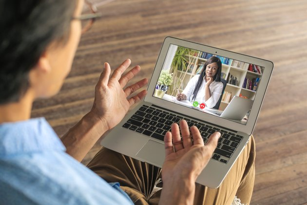 Man video calling his psychologist to have a virtual session while in quarantine during the coronavirus