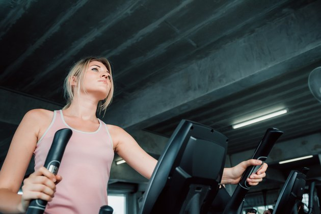 Portrait of sporty woman exercising elliptical in fitness gym., Group of pretty women in sportswear working out cardio training at gym.,Wellness program and sport healthy concept.