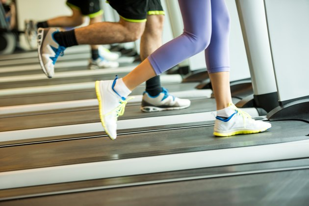 Couple exercising on treadmills in the gym
