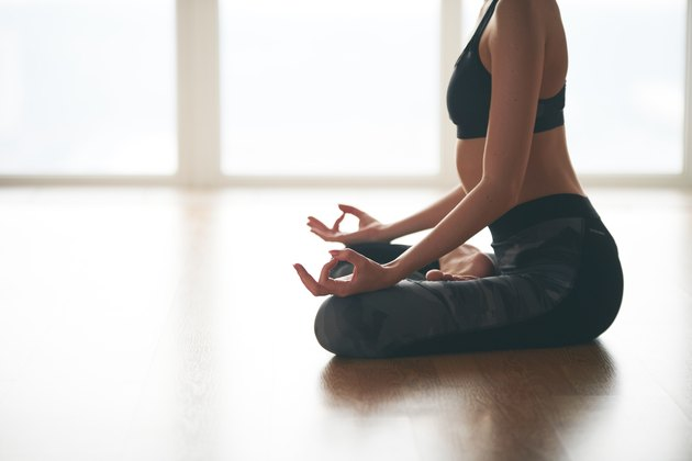 Woman doing mudra during yoga flow