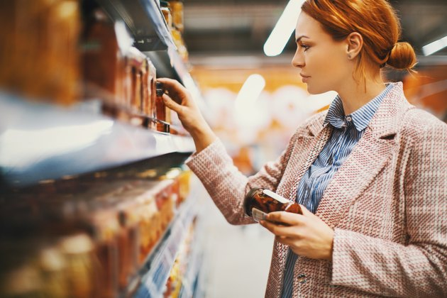 Woman looking at food in grocery store