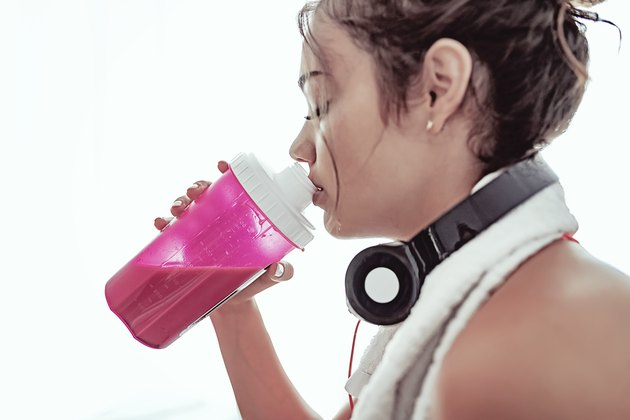 Woman drinking protein powder shake