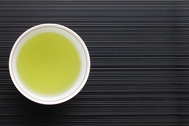 View from looking down into a cup of green tea in a cup