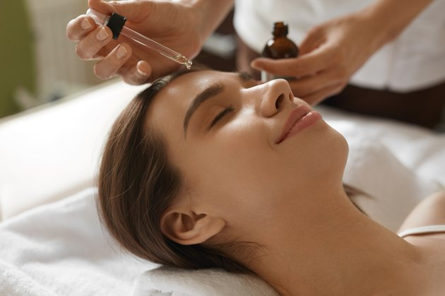 Face Skin Care. Woman Receiving Serum Treatment In Beauty Salon