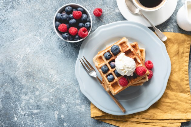 Belgian waffles with ice cream and berries