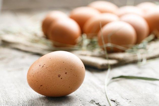 fresh organic farm eggs lie on burlap