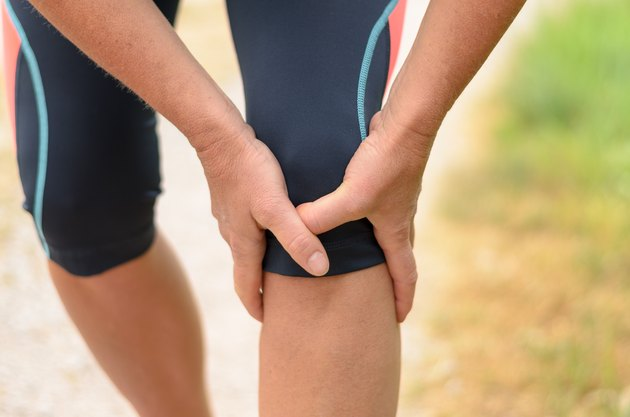 Midsection Of Woman Holding Knee