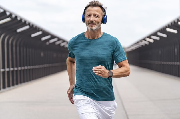 Sporty man wearing headphones and jogging