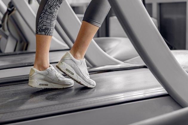 Legs of woman running on treadmill