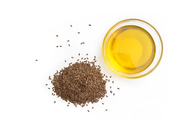 Linseed (flax seed oil) isolated on white background
