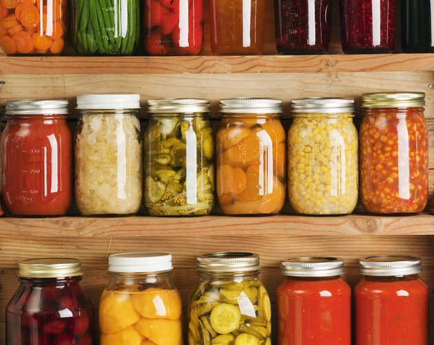 colorful Fruit and Vegetables in glass jars on storage Shelves
