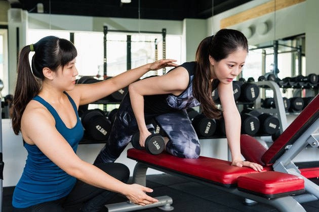 Woman do one-arm dumbbell row exercise