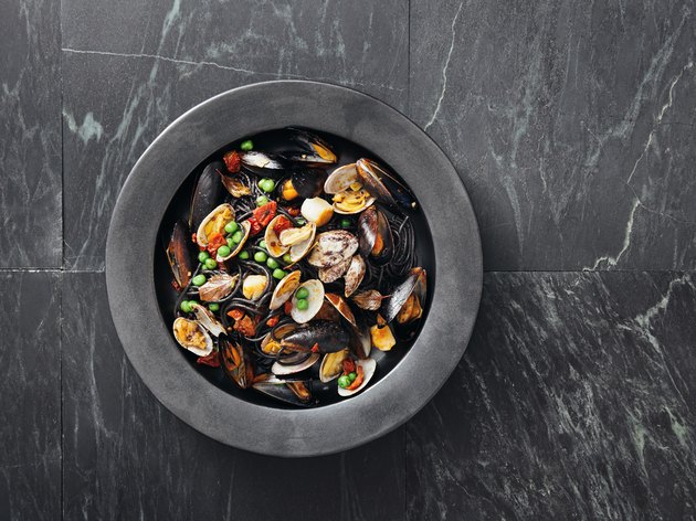 Squid ink pasta with seafood and vegetables
