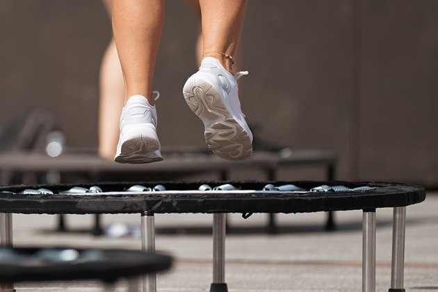 Fitness women jumping on small trampolines