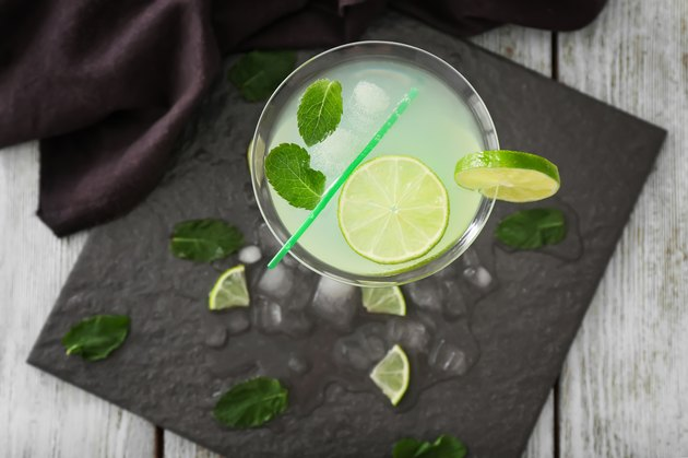 Fresh summer cocktail in glass on slate plate