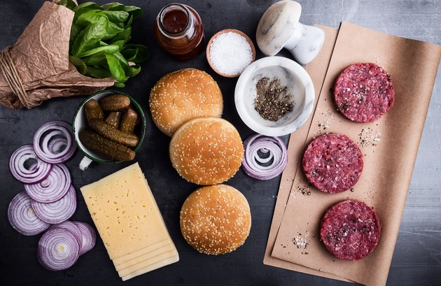 Raw beef meat burger cutlets with ingredients