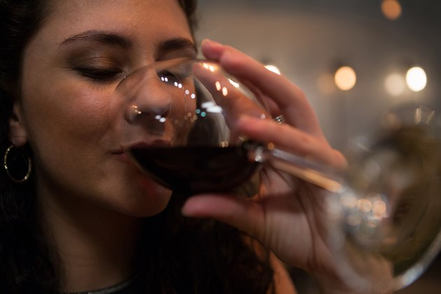 Beautiful woman having red wine