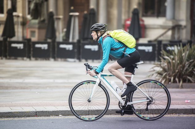 Woman commuting by bicycle on city street