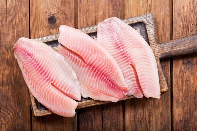 fresh fish fillet on wooden board