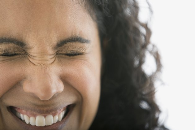 Close up portrait of smiling woman squinting