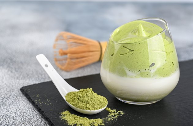Dalgona Matcha Latte, a creamy whipped matcha, on light background. Matcha green tea.