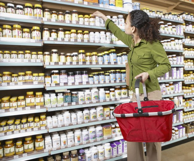 Woman shopping for types of potassium supplements
