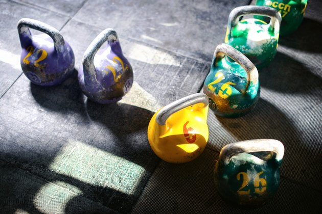 Kettlebells on a gym floor for a weight-lifting workout for weight loss