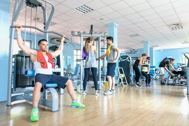 Group of sportive friends at gym fitness club center studio