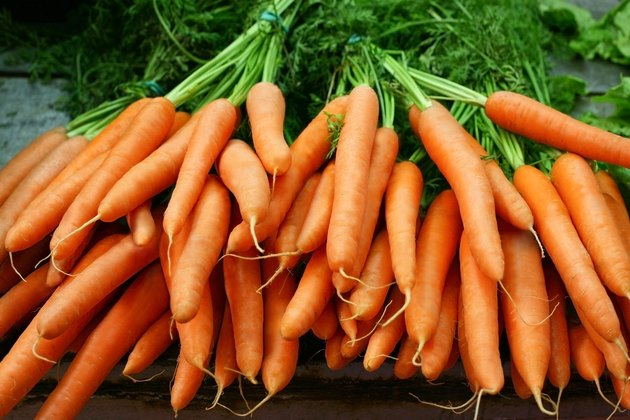 Bundles of organic carrots with the stems still attached
