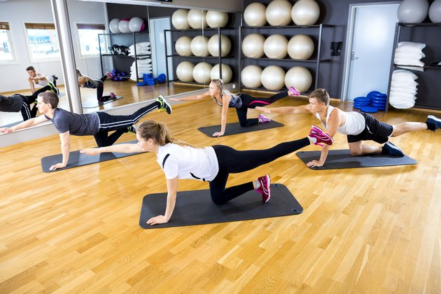 Team exercise core strength and balance at fitness gym