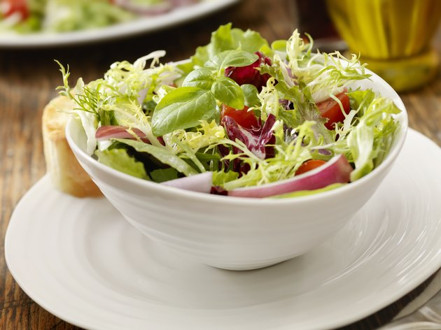 Side view of a fresh garden salad in a bowl