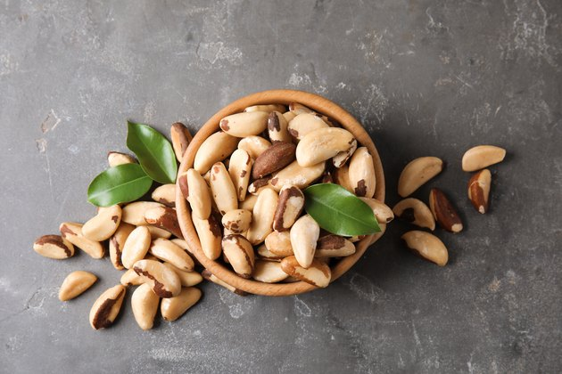 Flat lay composition with Brazil nuts on grey background