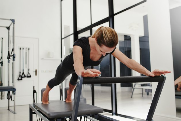 Woman doing Pilates on the reformer