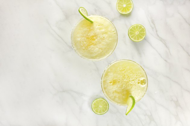 Lemon Margarita cocktails with limes and copy space