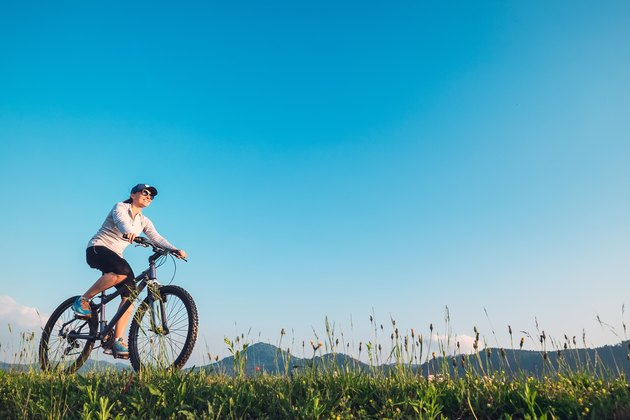 Woman ride a bike: summertime activity
