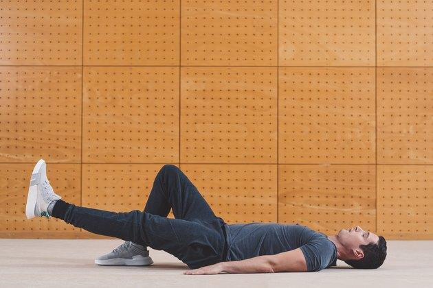 Man doing single-leg glute bridge for stronger gluteus maximus muscles