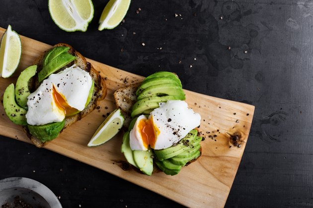 Vegetarian sandwiches with poached egg and sliced avocado