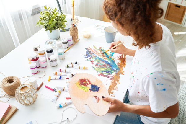 Creative Young Woman Painting Pictures