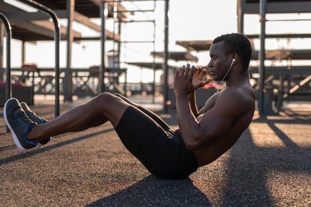Fit black man doing ab exercises